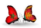 Dos mariposas con banderas de marruecos y sri lanka — Foto de Stock