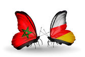 Dos mariposas con banderas marruecos y el sur de osetia — Foto de Stock