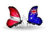 Due farfalle con le bandiere della lettonia e australia — Foto Stock