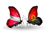 Two butterflies with flags of Latvia and Angola — Stock Photo