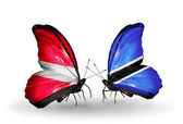 Two butterflies with flags of Latvia and Botswana — Stock Photo