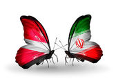 Two butterflies with flags of Latvia and  Iran — Stock Photo