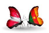 Two butterflies with flags of Latvia and  Cameroon — Stock Photo