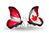 Two butterflies with flags of Latvia and  Canada — Stock Photo