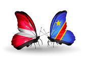 Dwa motyle z flagami łotwa i kongo — Zdjęcie stockowe