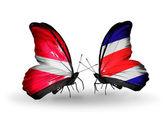 Two butterflies with flags of Latvia and  Costa Rica — Stockfoto