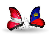 Two butterflies with flags of Latvia and Liechtenstein — Stock Photo