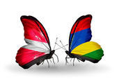 Two butterflies with flags of Latvia and Mauritius — Stock Photo