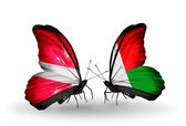 Two butterflies with flags of Latvia and Madagascar — Stock Photo