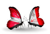Two butterflies with flags of  Latvia and Malta — Stock Photo