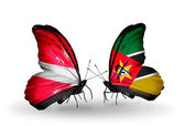 Butterflies with flags of Latvia and Mozambique — 图库照片