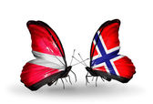 Butterflies with flags of Latvia and Norway — Stock Photo