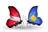 Butterflies with flags of Latvia and Palau — Stock Photo
