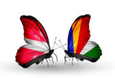 Butterflies with flags of Latvia and Seychelles — Stock Photo