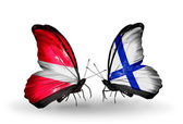 Butterflies with flags of Latvia and  Finland — Stock Photo