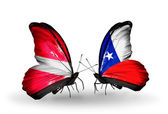 Butterflies with flags of Latvia and Chile — Stock Photo
