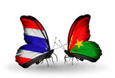 Two butterflies with flags of Thailand and Burkina Faso — Stock Photo