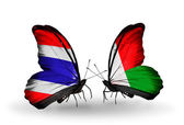 Two butterflies with flags of Thailand and Madagascar — Stockfoto