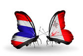 Butterflies with flags on wings of Thailand and Malta — Stock Photo