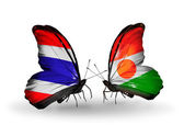 Butterflies with flags on wings of Thailand and Niger — Стоковое фото