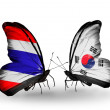 Butterflies with Thailand and South Korea flags on wings — Stock Photo