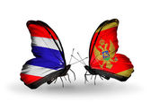 Butterflies with Thailand and Montenegro flags on wings — Stock Photo