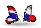 Butterflies with Thailand and Czech flags on wings — Stock Photo