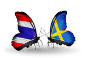 Butterflies with Thailand and Sweden flags on wings — Stock Photo