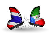 Butterflies with Thailand and Equatorial Guinea flags on wings — Stock Photo