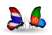 Butterflies with Thailand and Eritrea flags on wings — Stock Photo