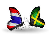 Butterflies with Thailand and Jamaica flags on wings — Stock Photo