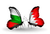 Butterflies with Bulgaria and Bahrain flags on wings — Stock Photo