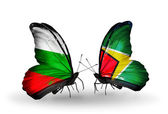 Butterflies with Bulgaria and Guyana flags on wings — Stock Photo