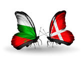 Butterflies with Bulgaria and Denmark flags on wings — Stock Photo