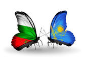 Butterflies with Bulgaria and Kazakhstan flags on wings — Stock Photo