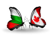 Butterflies with Bulgaria and Canada flags on wings — Stock Photo