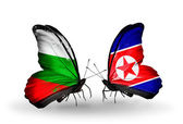 Butterflies with Bulgaria and North Korea flags on wings — Stock Photo