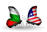 Butterflies with Bulgaria and Liberia flags on wings — Stock Photo