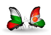 Butterflies with Bulgaria and Niger flags on wings — Stock Photo