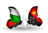 Butterflies with Bulgaria and Papua New Guinea flags on wings — Stock Photo
