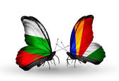 Butterflies with Bulgaria and Seychelles flags on wings — Stock Photo