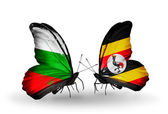 Butterflies with Bulgaria and Uganda flags on wings — Stok fotoğraf