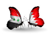 Butterflies with Syria and Bahrain flags on wings — Stockfoto