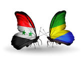 Butterflies with Syria and Gabon flags on wings — Stock Photo