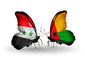 Butterflies with Syria and Guinea Bissau flags on wings — Stockfoto