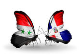 Butterflies with Syria and Dominicana flags on wings — Stockfoto