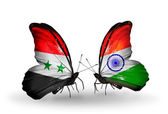 Butterflies with Syria and India flags on wings — Stok fotoğraf