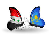 Butterflies with Syria and Kazakhstan flags on wings — Stock Photo