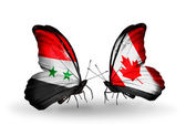 Butterflies with Syria and Canada flags on wings — Stockfoto