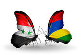 Butterflies with Syria and Mauritius flags on wings — Stock Photo